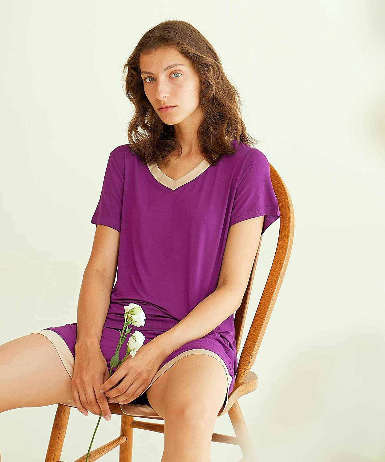 model wearing the purple pajama set