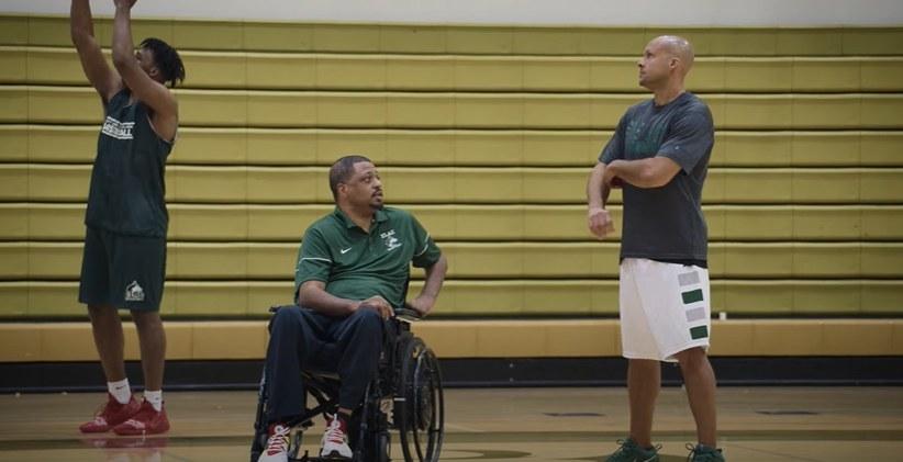 Coach Hunter talking to Coach Robinson