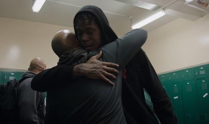 Coach Mosley hugging Joe Hampton