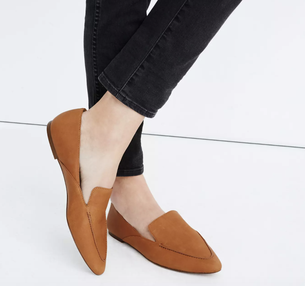 a model light brown loafers with a pointed toe