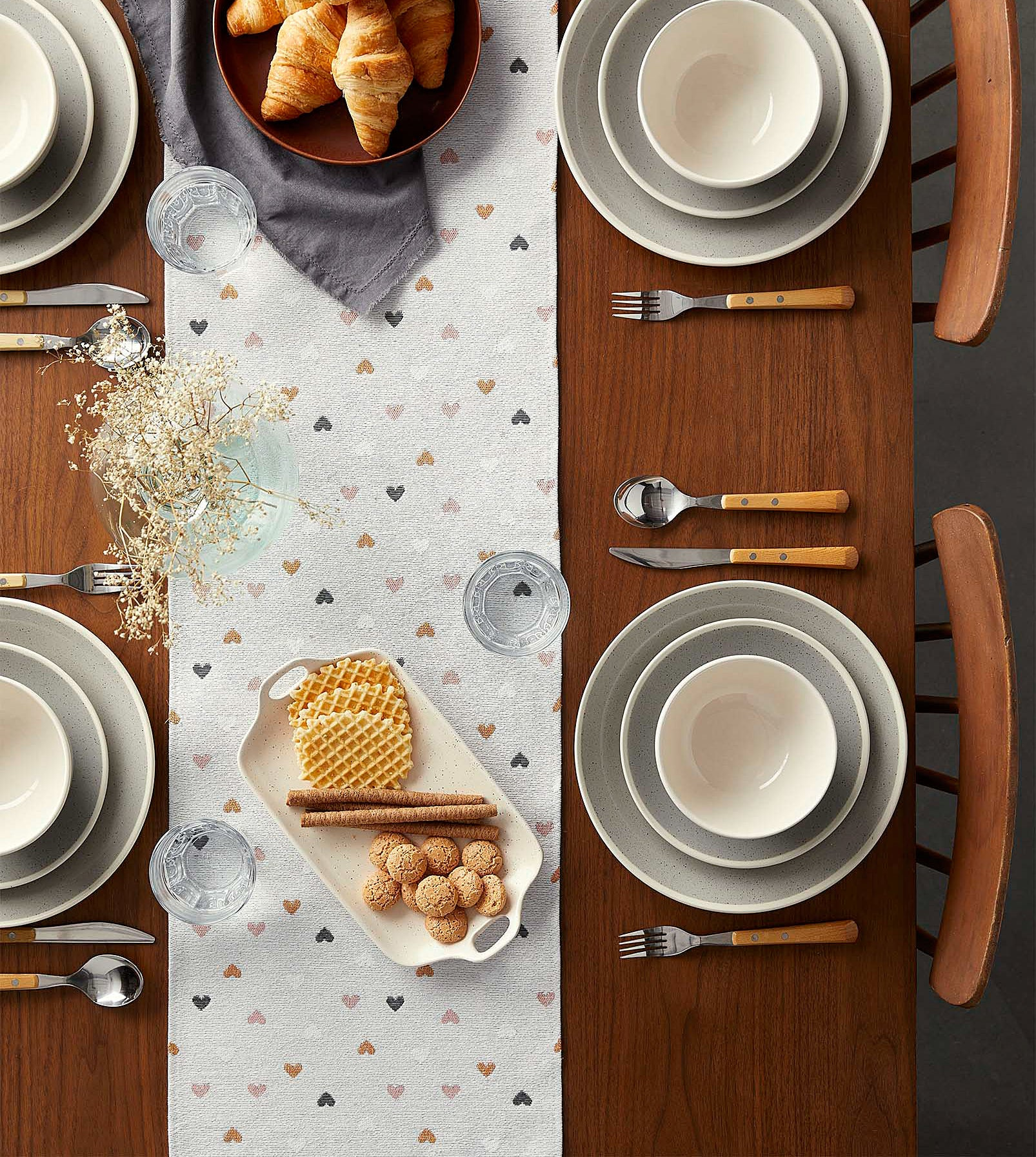The table runner dotted with hearts laying flat on a table