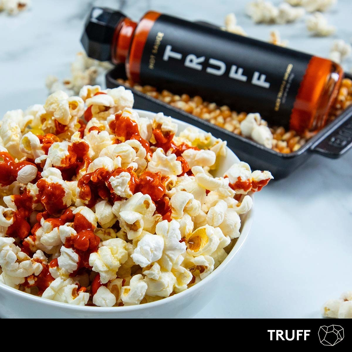 the hot sauce drizzled over popcorn