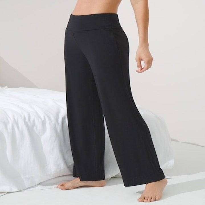 model wearing the high-waisted black pants