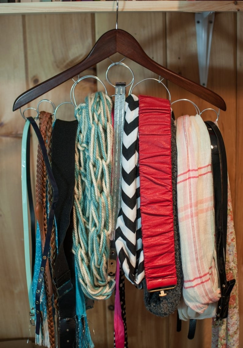 Scarf hanger with various scarves placed inside