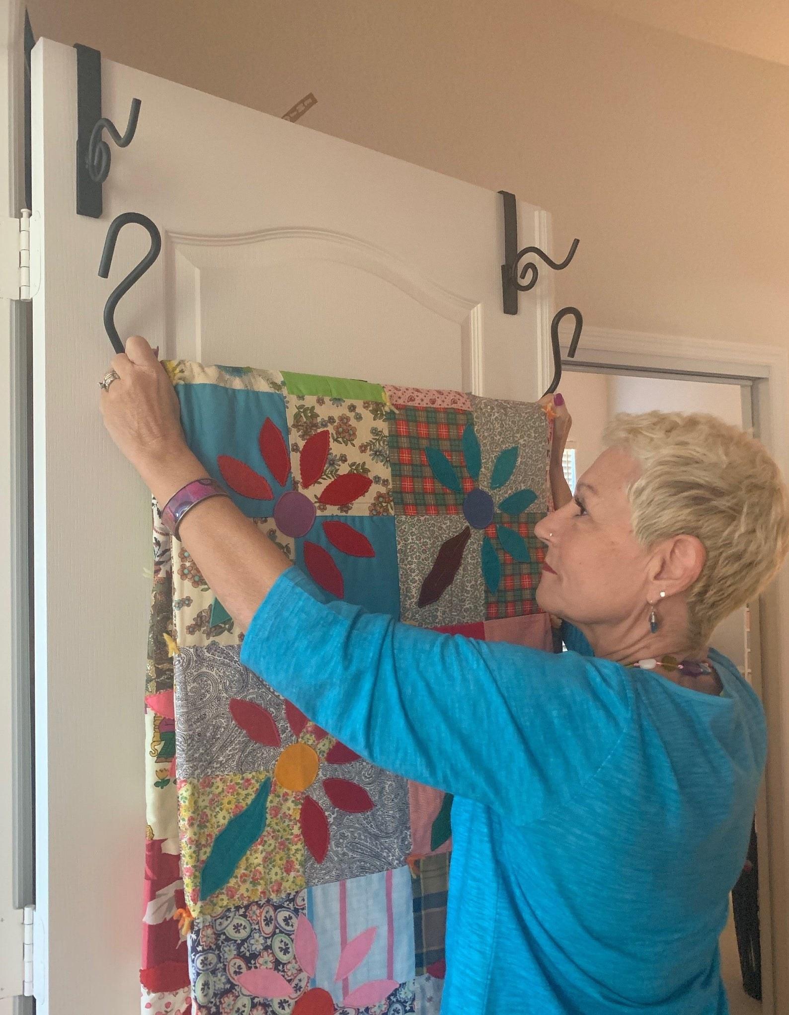 Model hanging quilt on over-the-door hanger