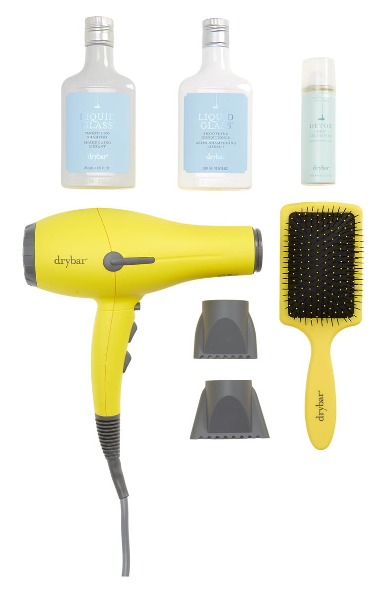 the set with a yellow blow dryer, brush, shampoo, conditioner, and dry shampoo