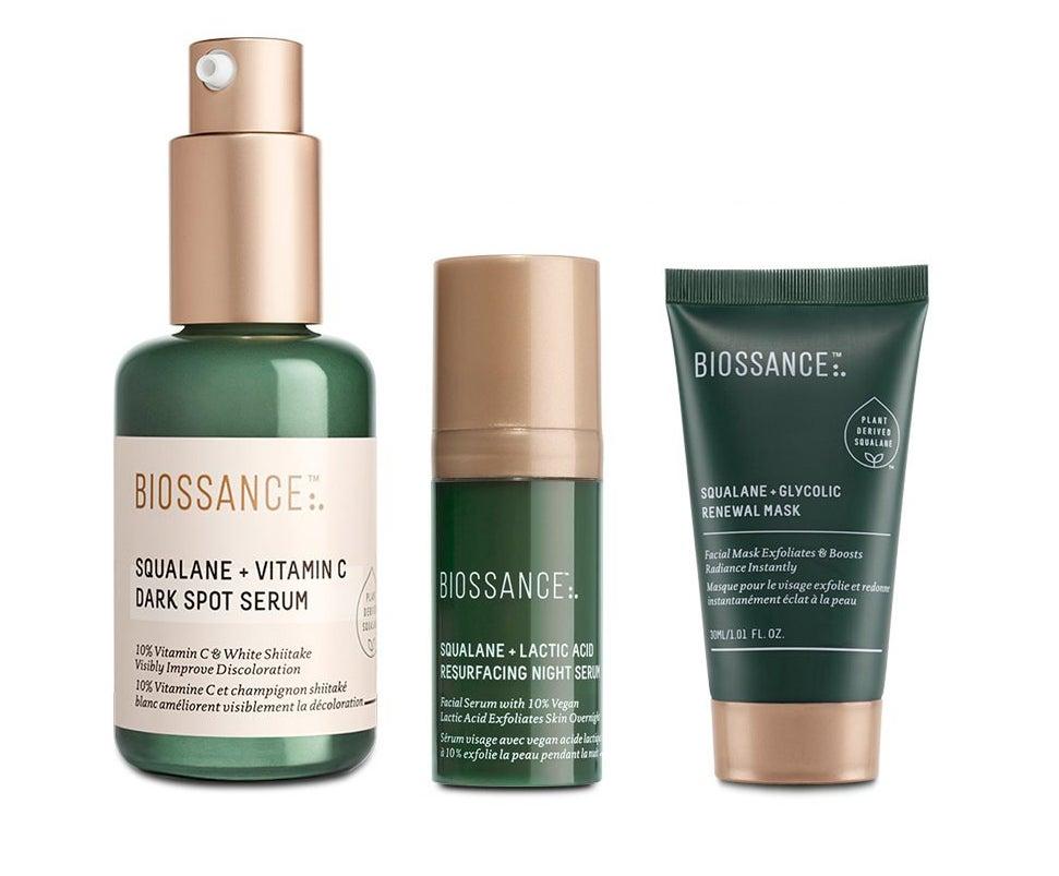 the trio (dark spot serum, resurfacing night serum, and renewal mask) in dark green bottles and containers