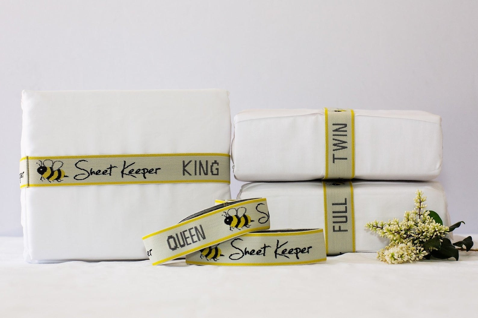 Three sheet sets with sheet keeper wrapped around