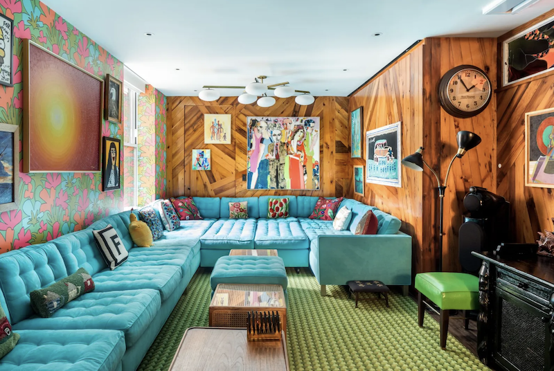 The L-shaped couch spans three walls