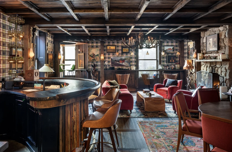The saloon has a stone fireplace and rustic decor