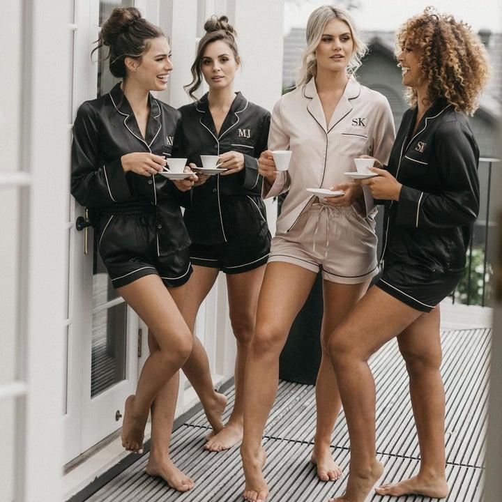 models wearing the black and pink pajama sets