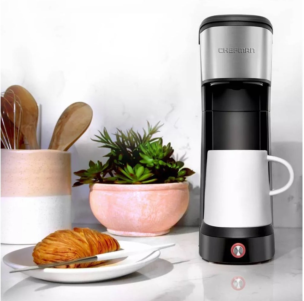 The slim black and silver coffee maker on a kitchen counter
