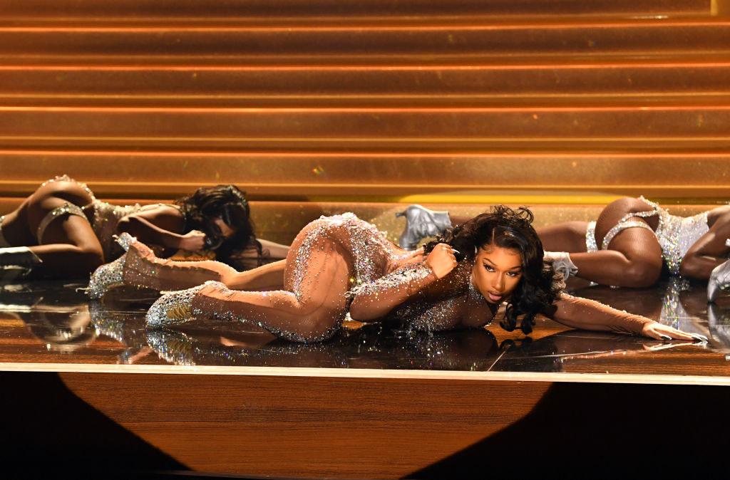 Megan dancing on the floor in a sparkly bodysuit