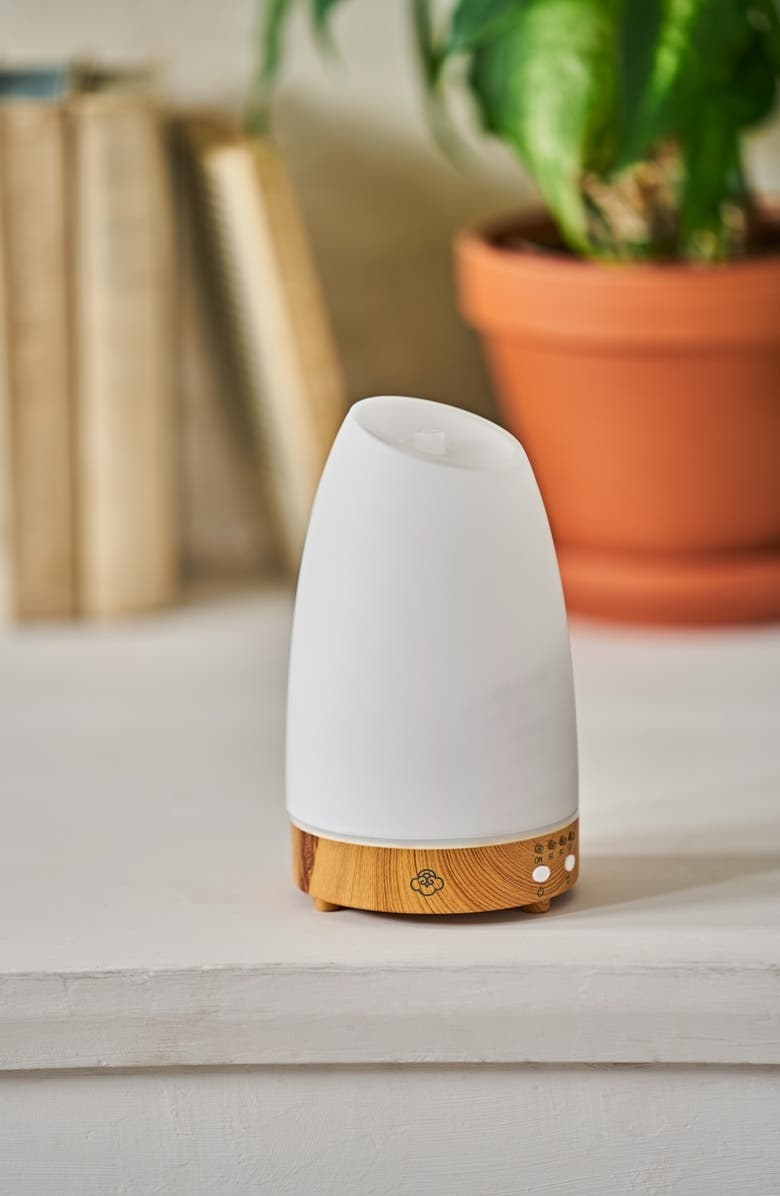 White and brown essential oil diffuser