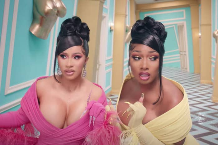 Cardi and Megan wandering the halls in matching dresses and up dos in the WAP music video