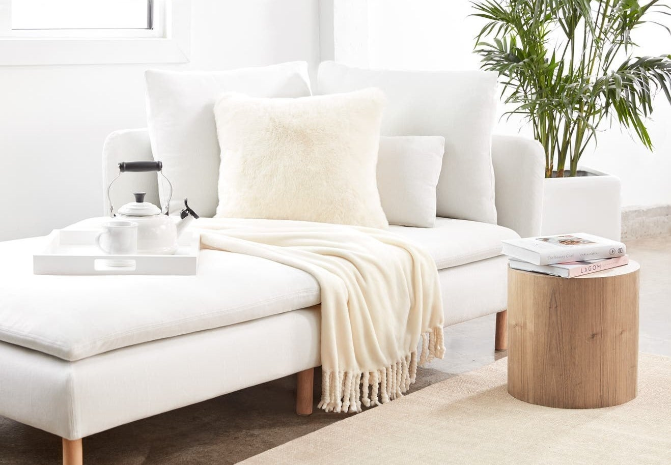 Cream plush blanket on a white couch