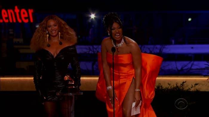 Megan and B accepting their award