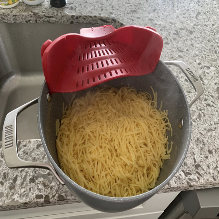 reviewer image of pasta pot with strainer in red