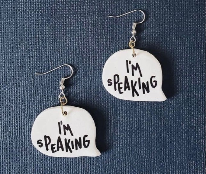"""A pair of dangle earrings shaped like speech bubbles that say """"I'm speaking"""""""