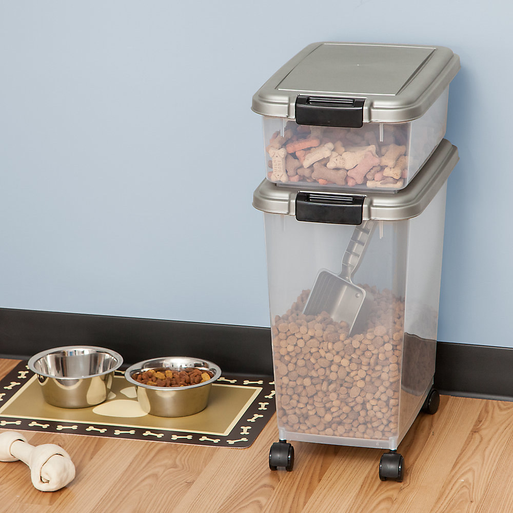 two food storage containers with dog food in it that's sitting in a room