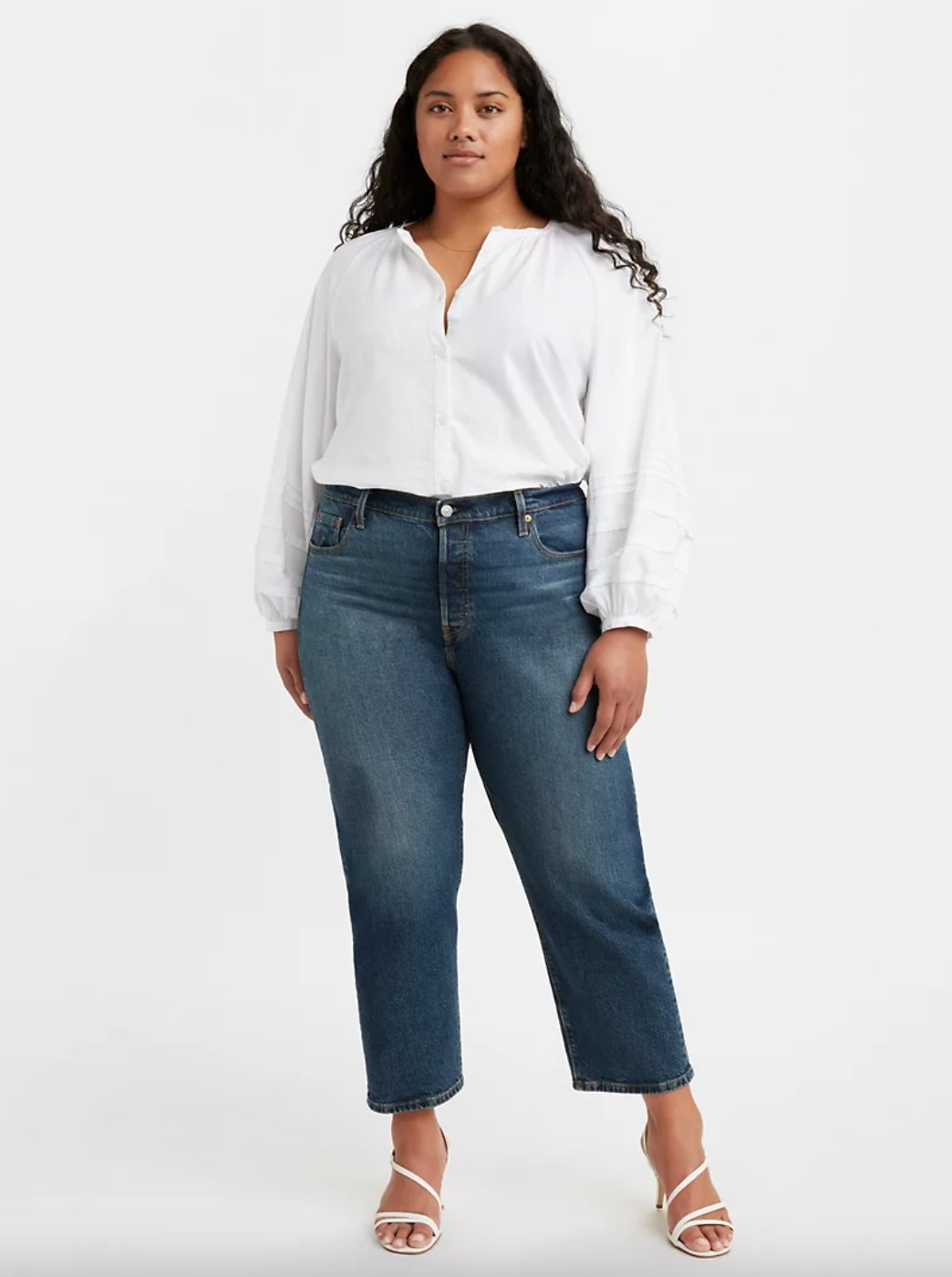 Model in the slightly cropped wide leg jeans