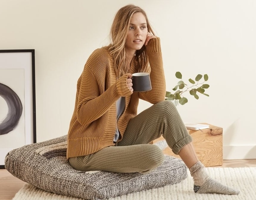 a model in olive green waffle knit joggers