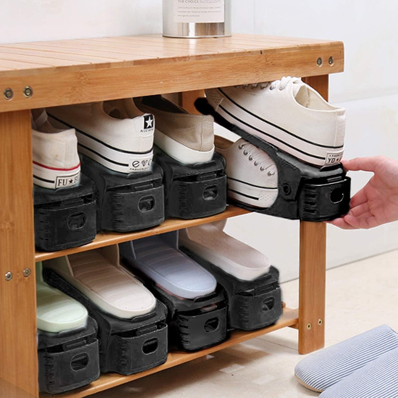 Model placing shoes on shoe holder into shoe rack