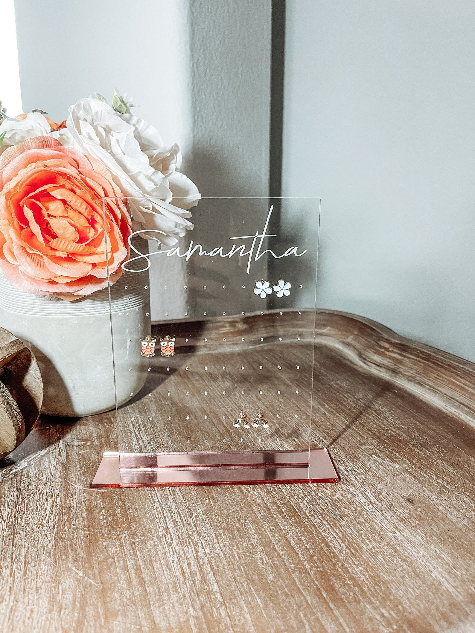 Personalized earring stand placed on table