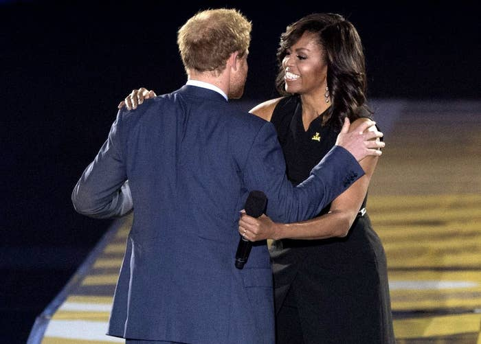 Michelle hugs Harry on stage