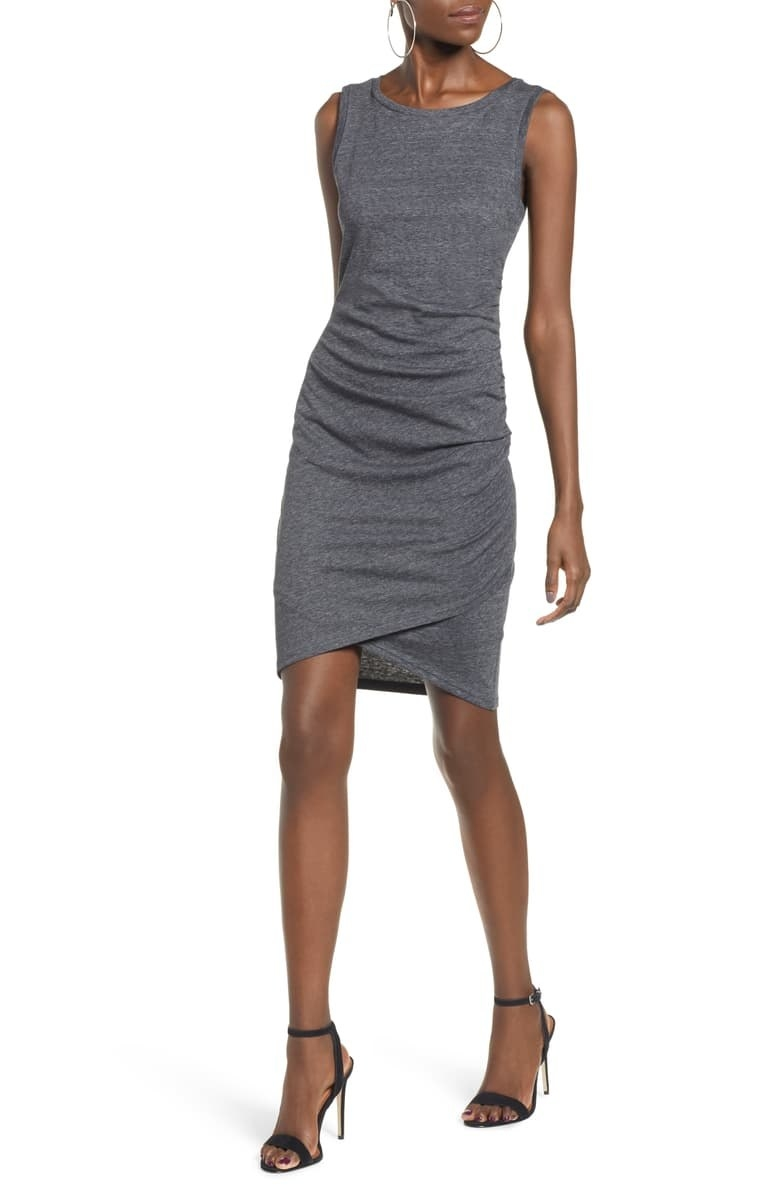 Model wears gray tank dress