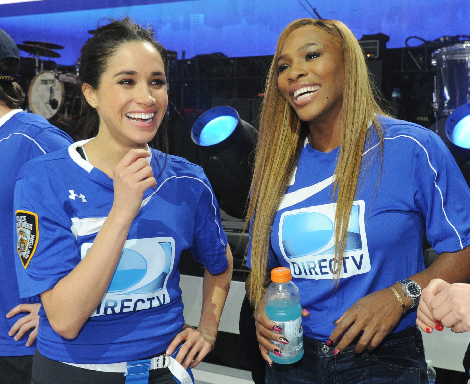 Meghan and Serena Williams laugh during a sporting event