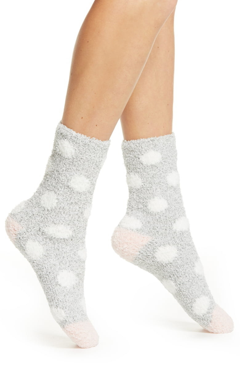 Model wears polka dot socks