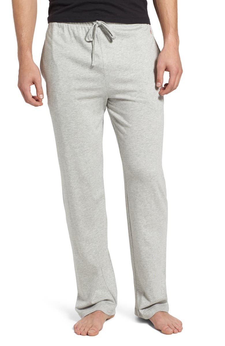 Model wears gray pajama pants with a black shirt