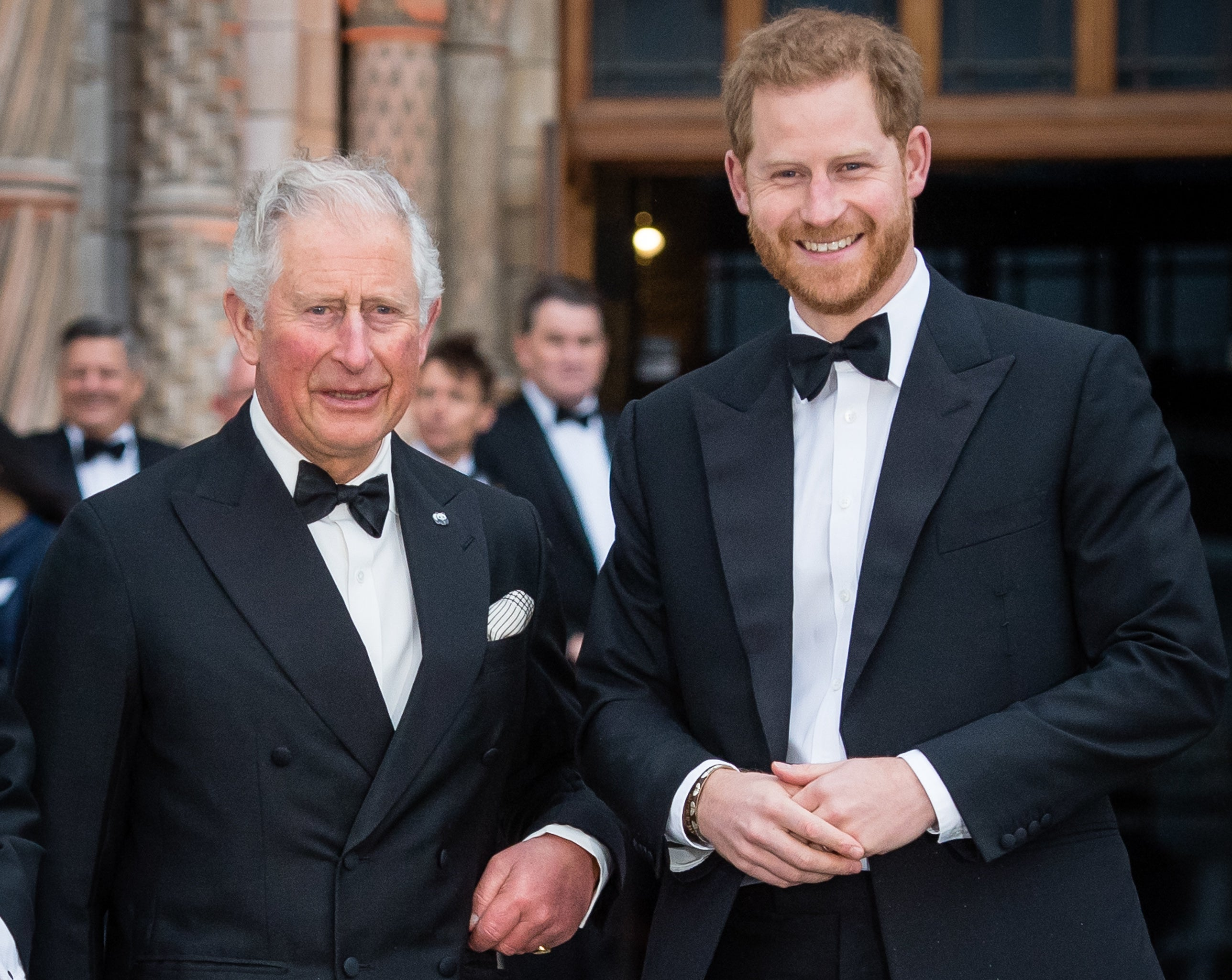 Harry stands next to his father, Prince Charles, during a black tie event