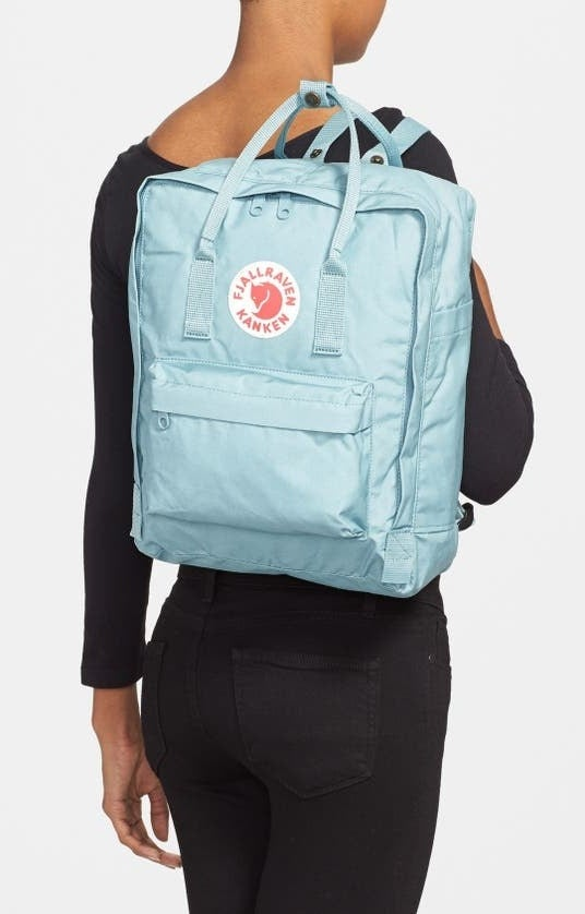 Model carries the sky blue kanken backpack