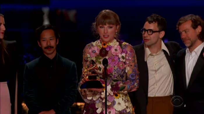 Taylor accepting her award with her collaborators