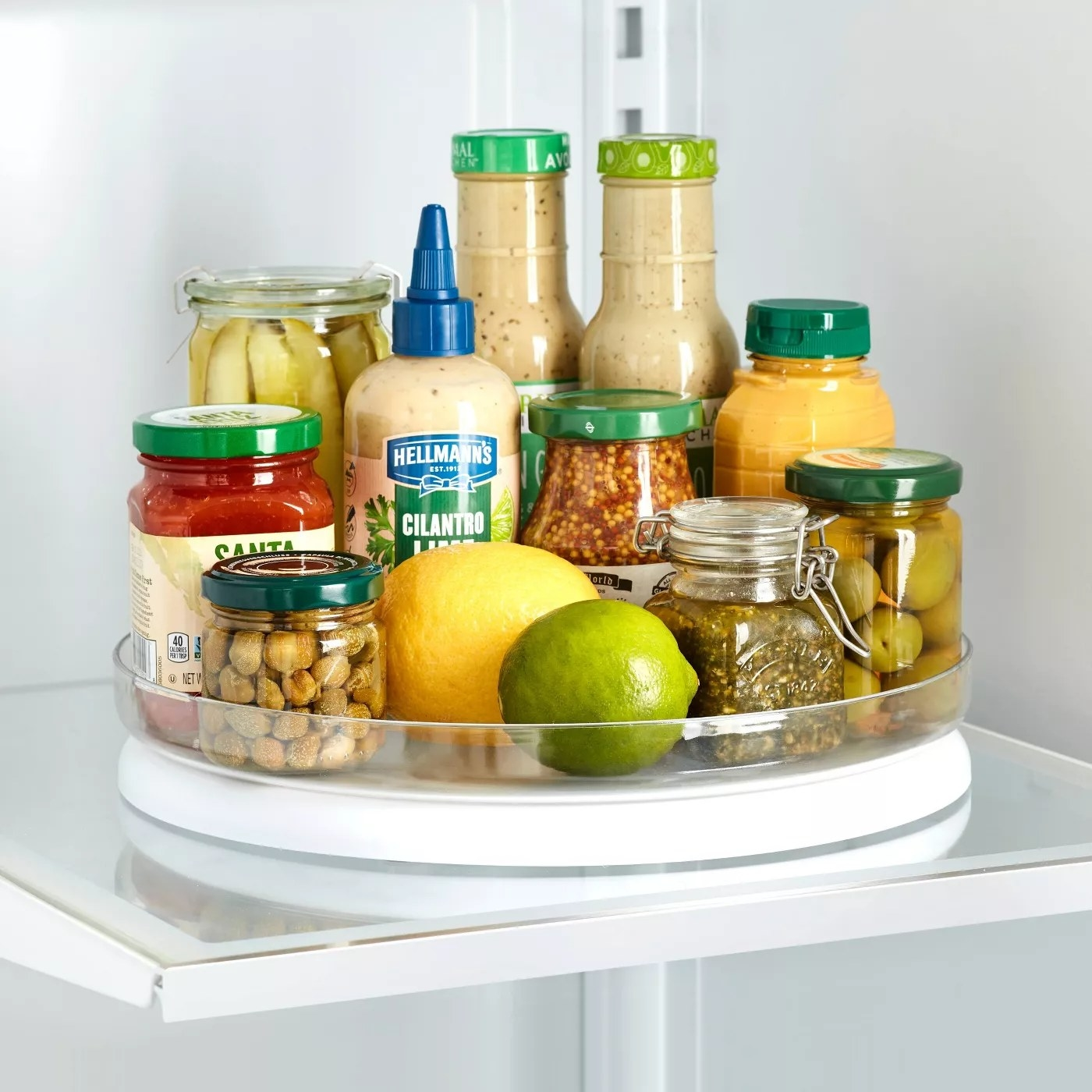 The turntable on a refrigerator shelf, filled with condiments