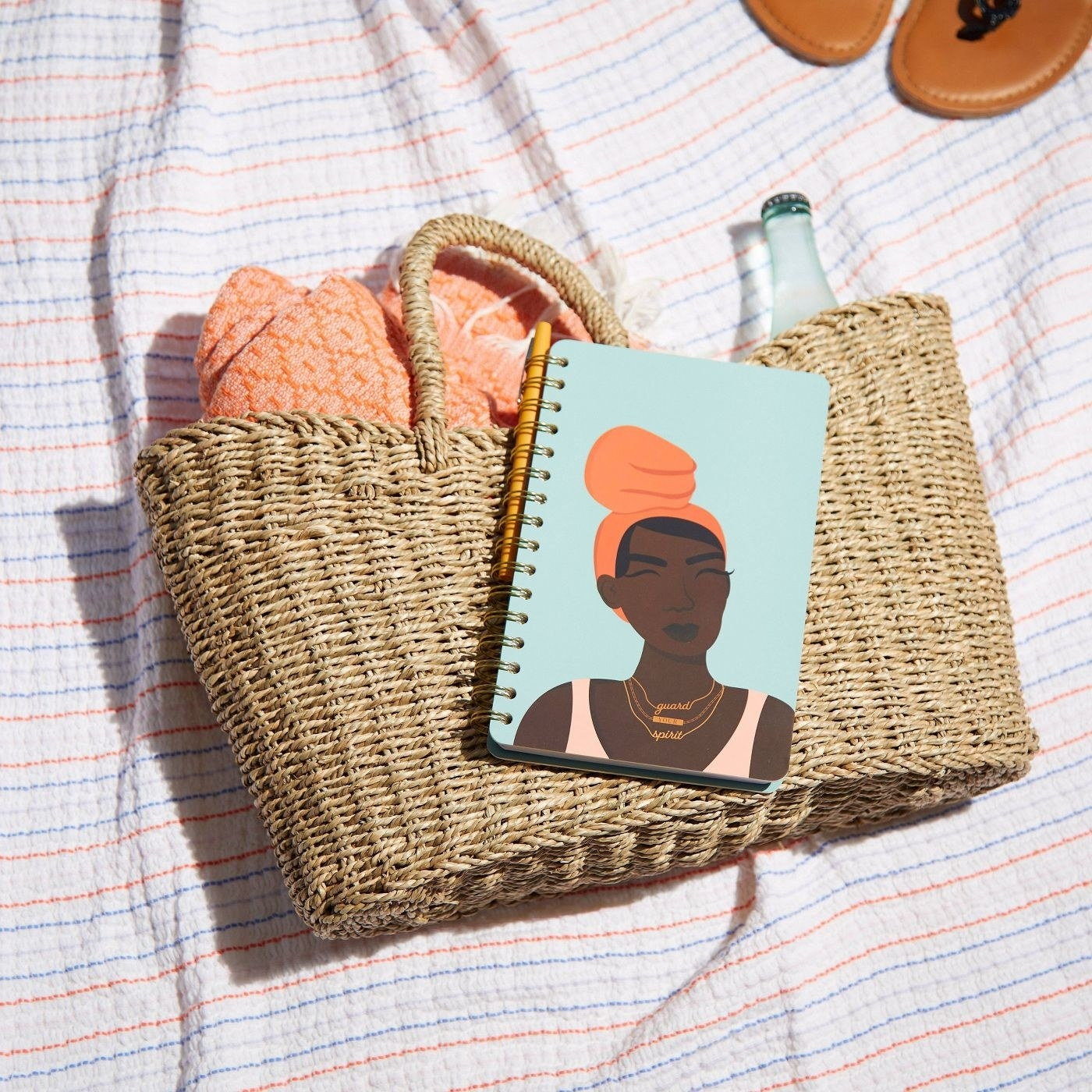 Light blue notebook with illustration of black woman wearing a necklace that says guard your spirit
