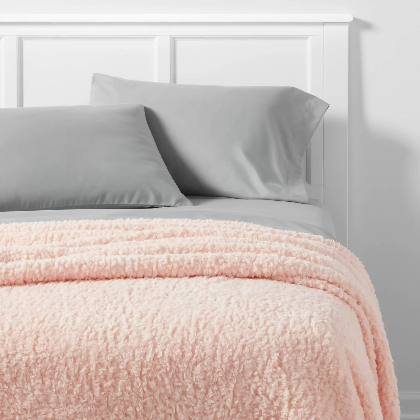 The pink blanket on a bed