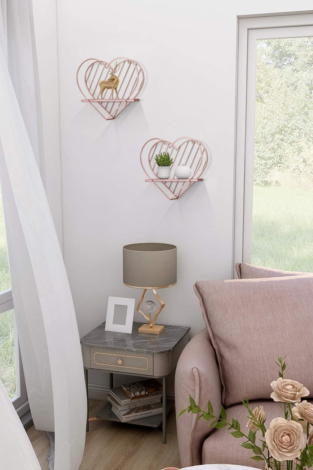 two of the heart-shaped shelves hanging in a living room