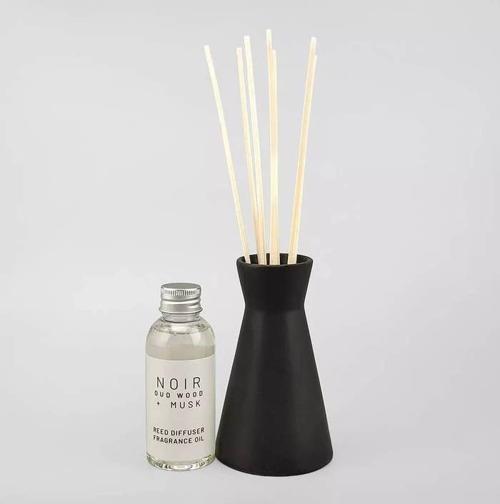The black reed diffuser with a separate fragrance bottle