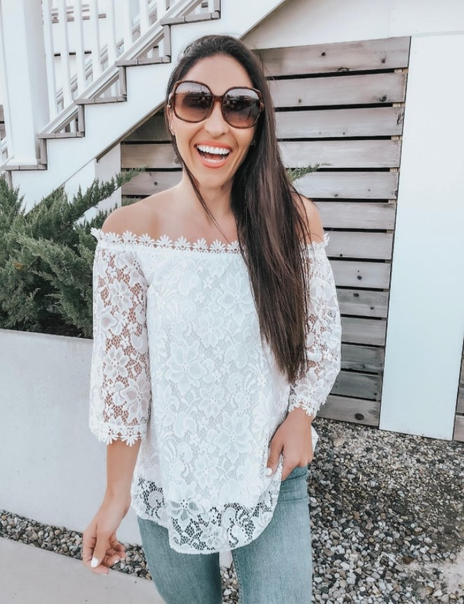 A reviewer wearing the top in white