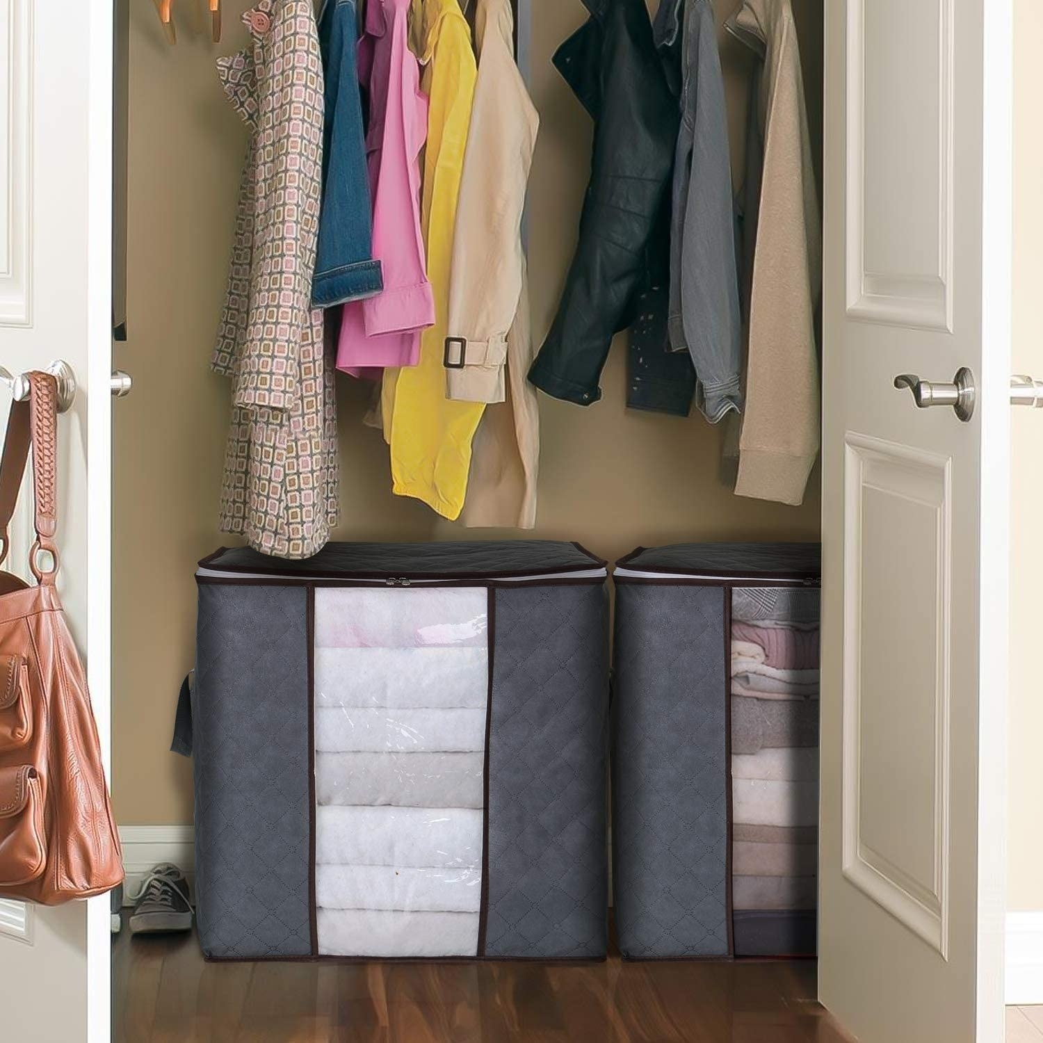 Two storage bags placed at bottom of closet