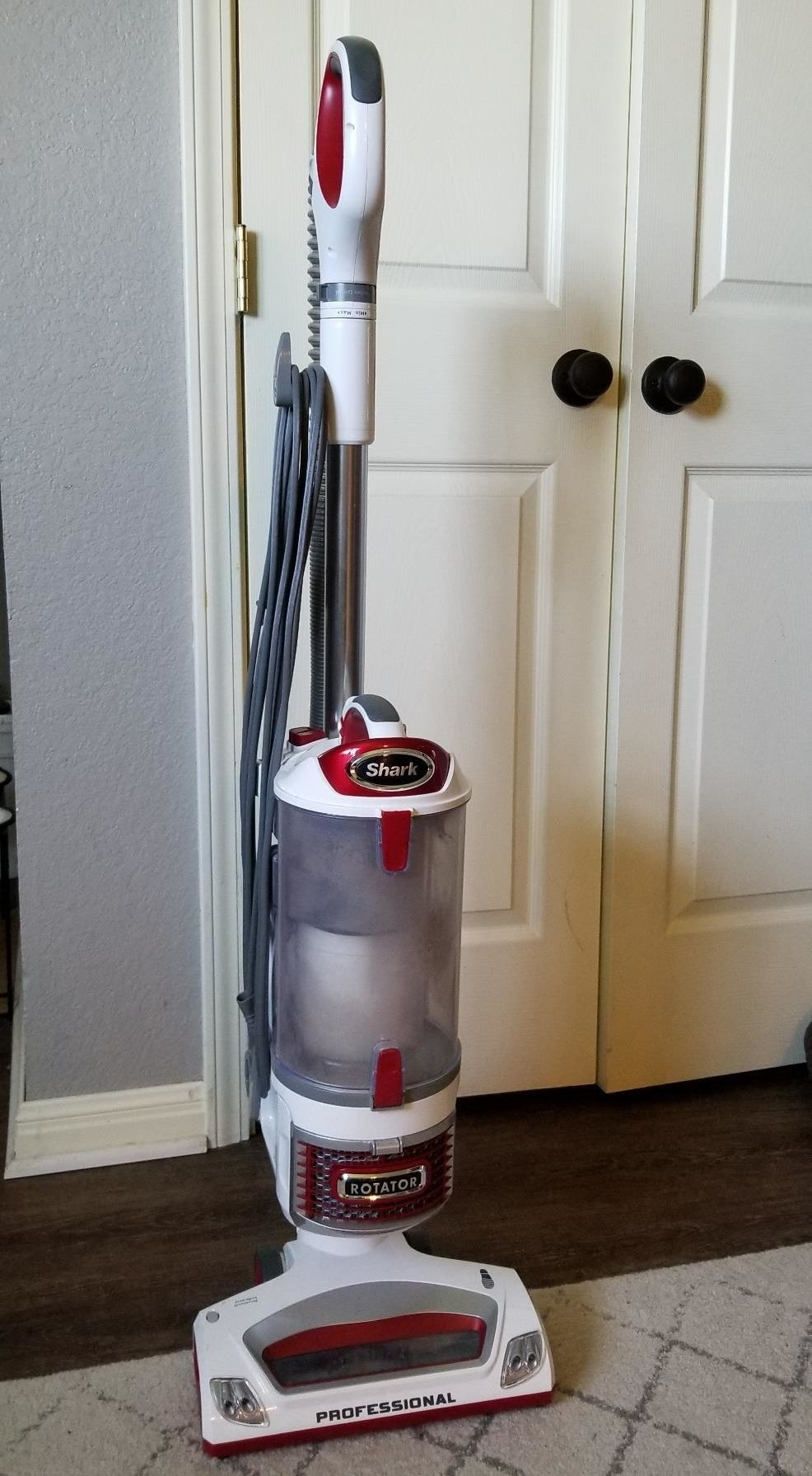 Reviewer photo of upright bagless red and white vaccuum with lift away pod