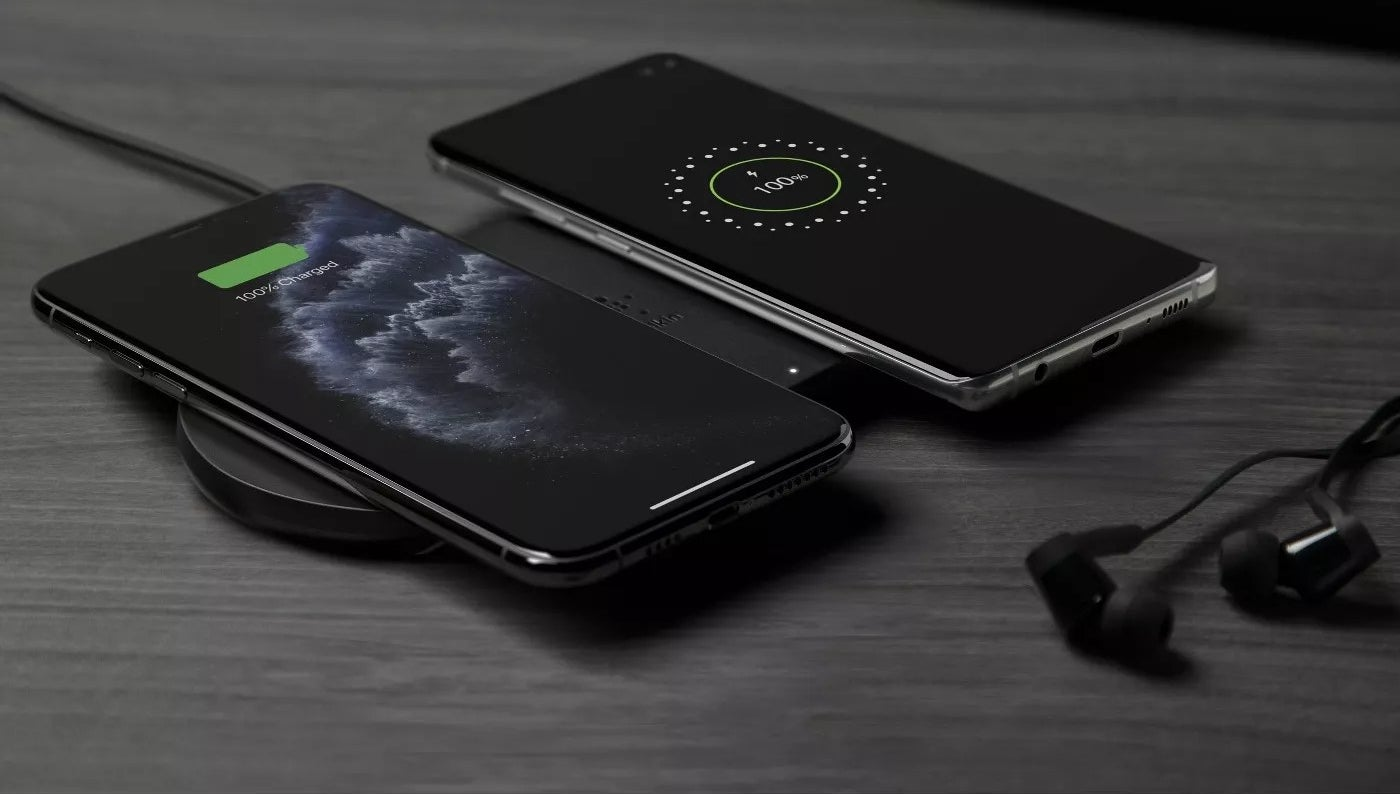Two phones charging on the charging pad simultaneously