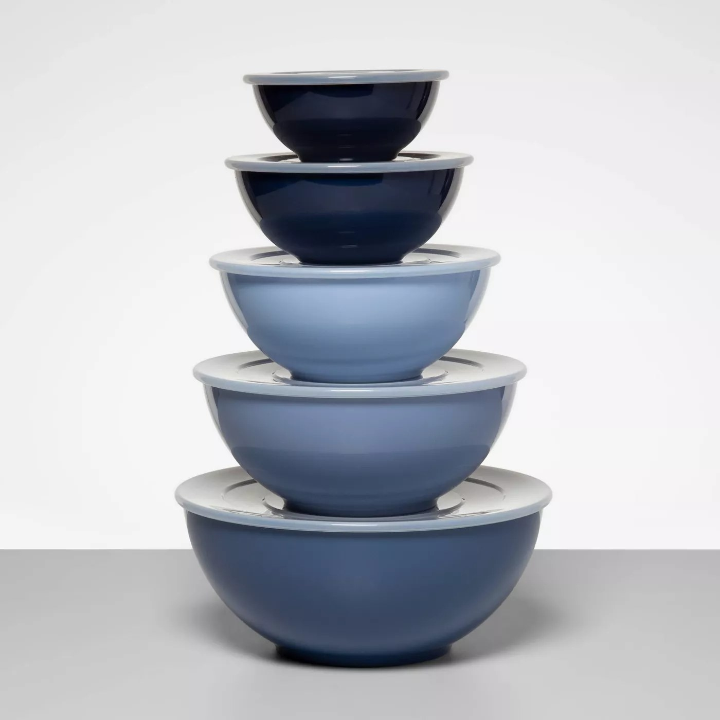 A tower of the five mixing bowls with the largest one on the bottom and the smallest one on top