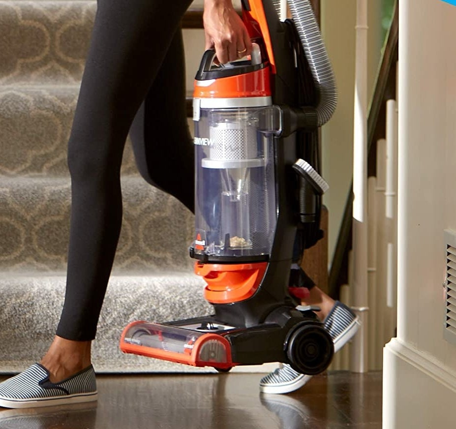 Model carrying orange corded Bissell vaccuum