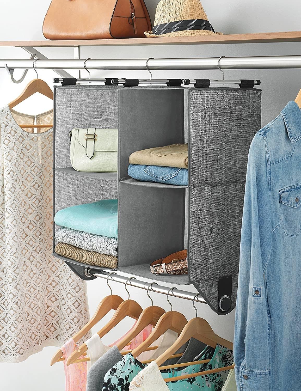 Hanging storage shelf with rod hanging in closet