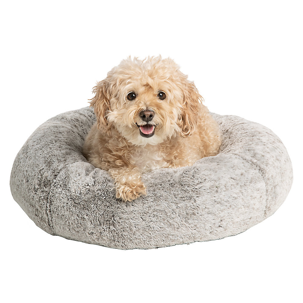 dog in a gray faux fur donut bed