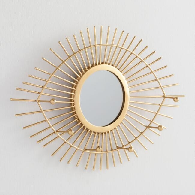 the gold mirror and jewelry holder